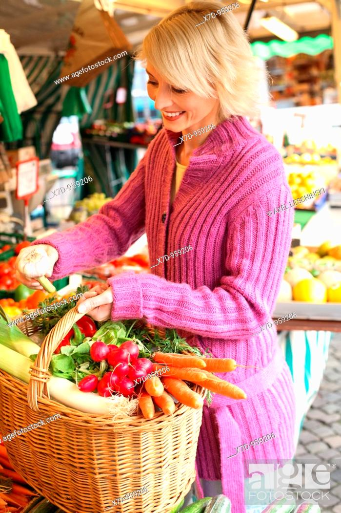 Stock Photo: Blond woman shopping on weekly market.