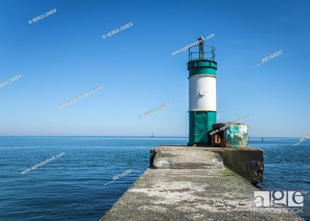 Stock Photo: Old lighthouse in the cargo port and container terminal in Odessa, Ukraine.