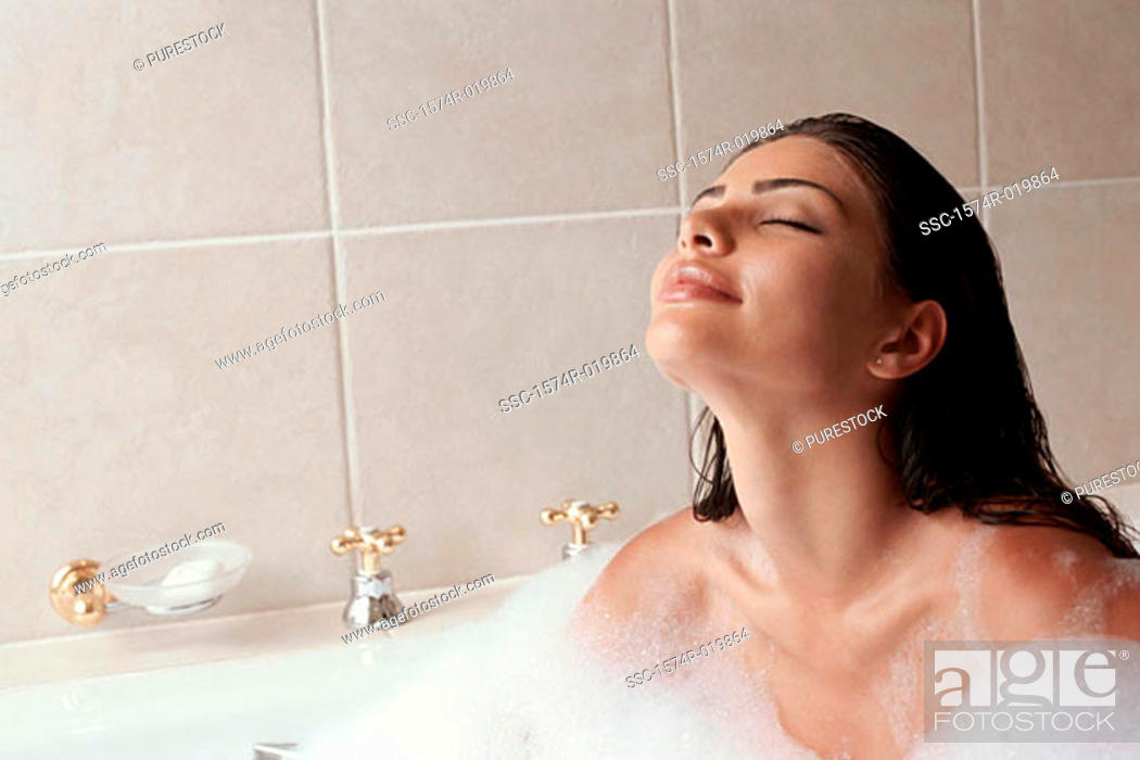 Stock Photo: Close-up of a young woman taking a bubble bath.