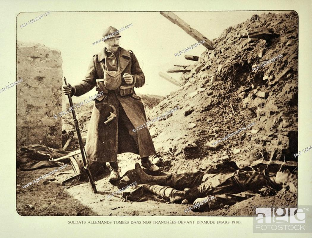 Stock Photo: Belgian soldier looking at dead German soldier killed in action in trench at Diksmuide in Flanders during the First World War, Belgium.