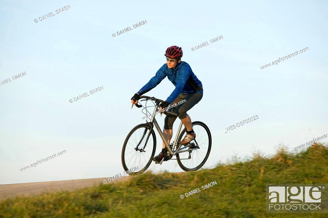 Stock Photo: Germany, Bavaria, Oberland, Man mountain biking.