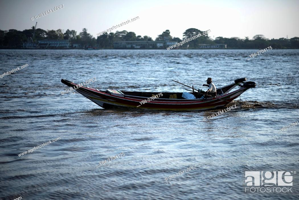 Stock Photo: A long boat at the Irrawaddy River in Yangon, Myanmar.