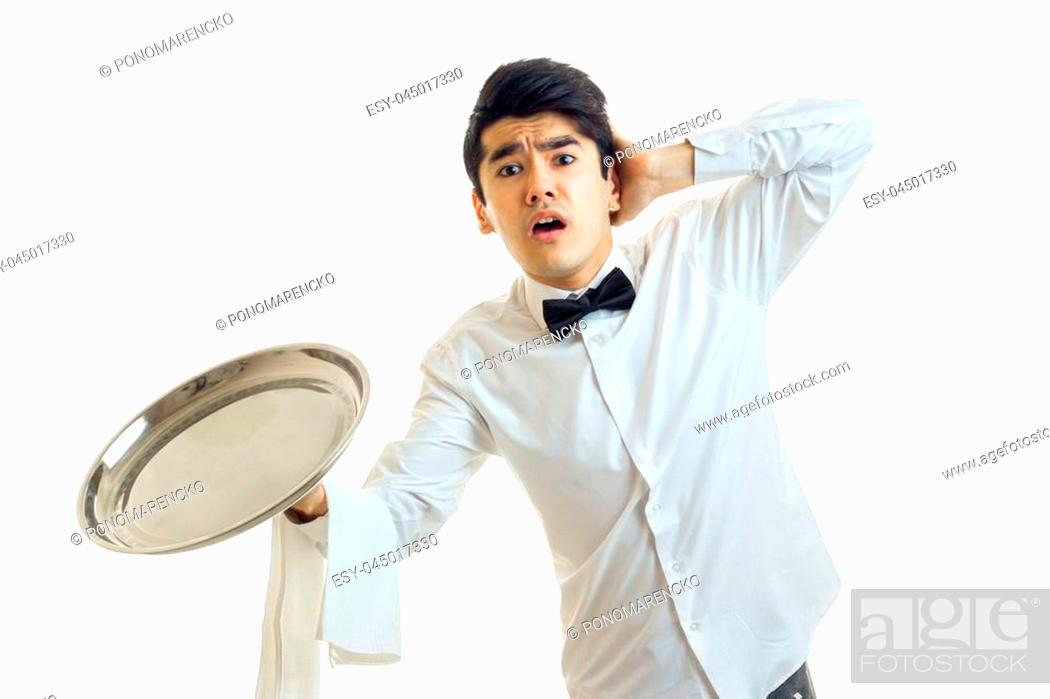 Photo de stock: the young waiter with an empty tray for cupboards opened his mouth and kept the ball for a head isolated on white background close-up.