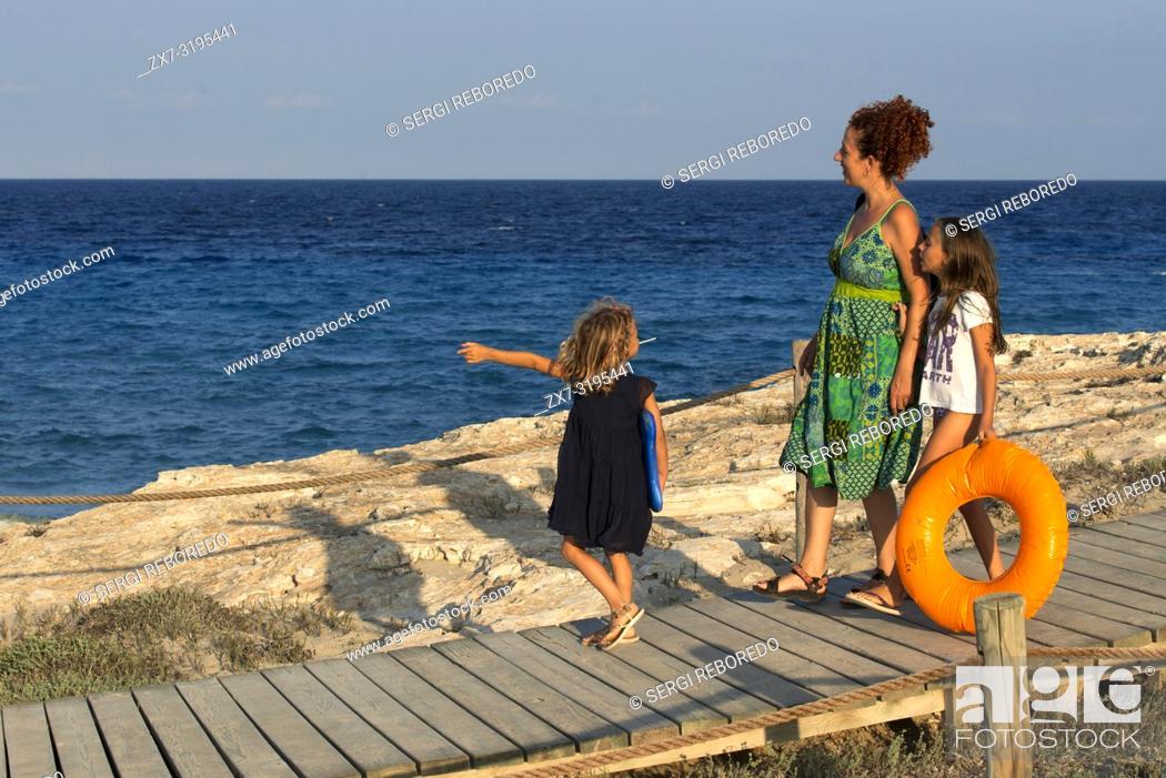 Stock Photo: Sa Roqueta Beach and Ses Illetes Beach, Balearic Islands, Formentera, Spain. Funy girls with floats.