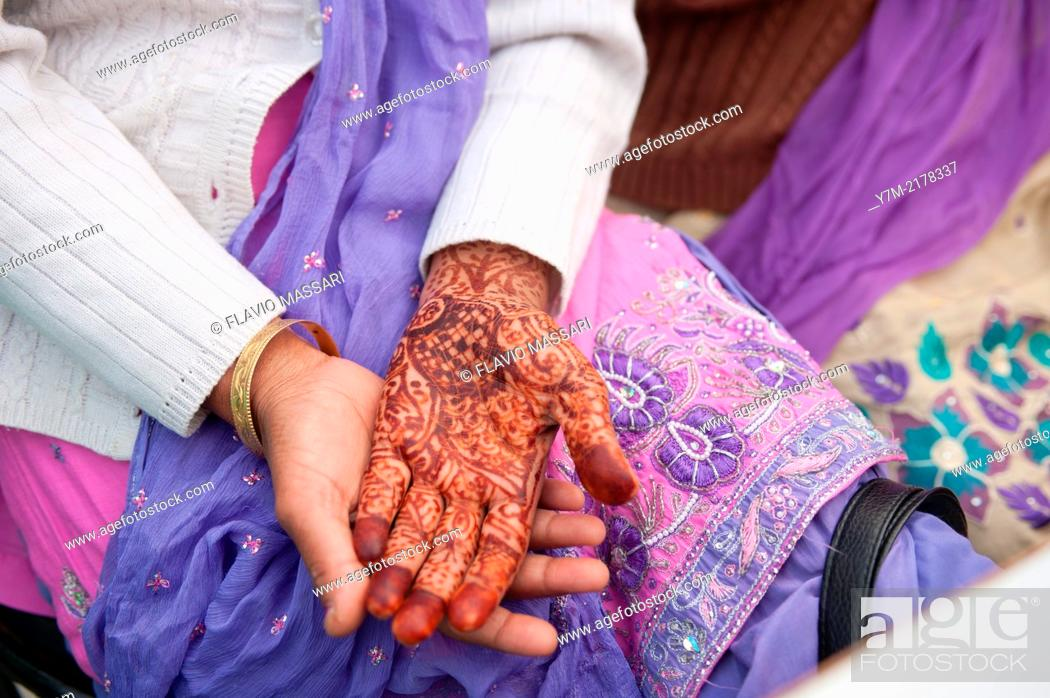 Stock Photo: India: Punjab: Woman with her hand painted with henna.
