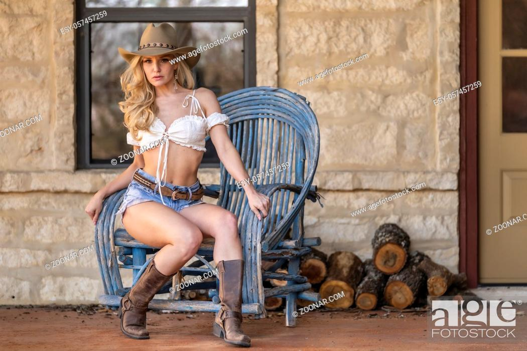 Stock Photo: A gorgeous blonde model dressed as a cowgirl enjoying the outdoor weather.