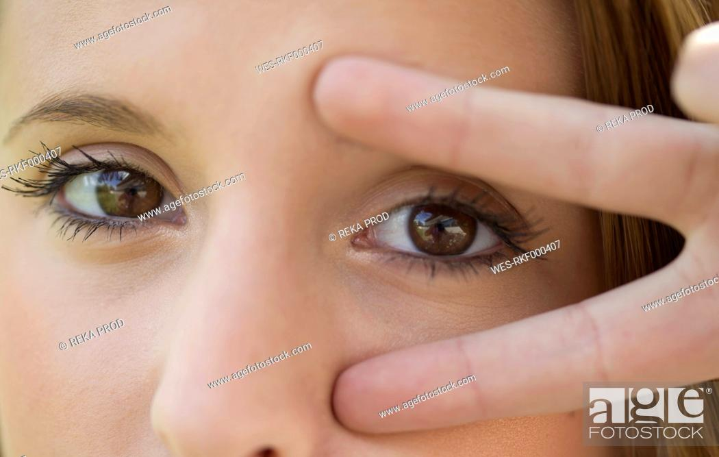 Stock Photo: Europe, Germany, North Rhine Westphalia, Duesseldorf, Close up of young woman.