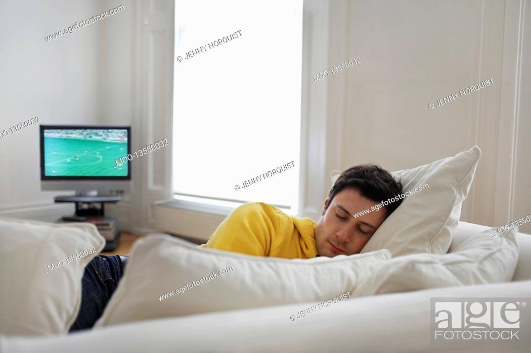 Stock Photo: Man sleeping on sofa.