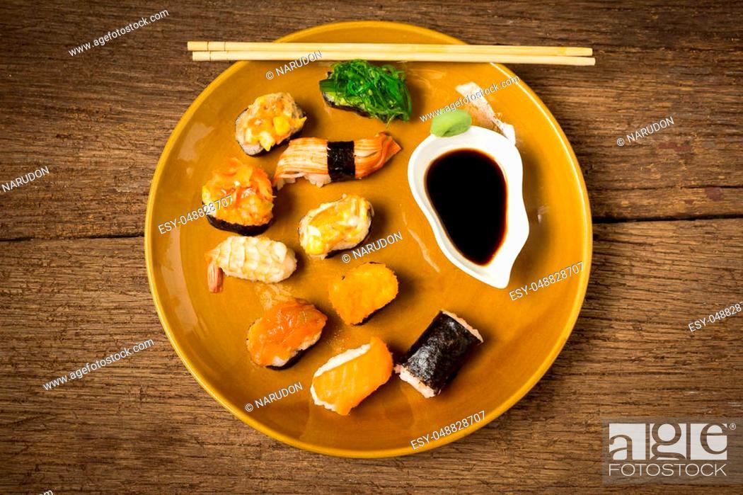 Stock Photo: Japanese Cuisine Sushi on old wood.