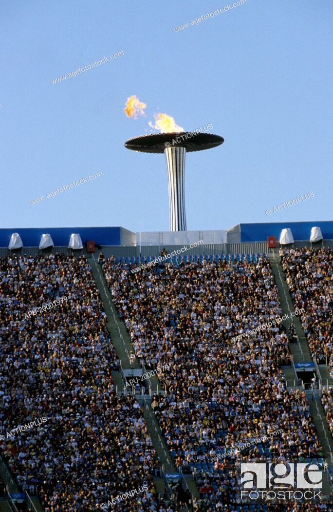 Stock Photo: Olympic torch above a stadium.