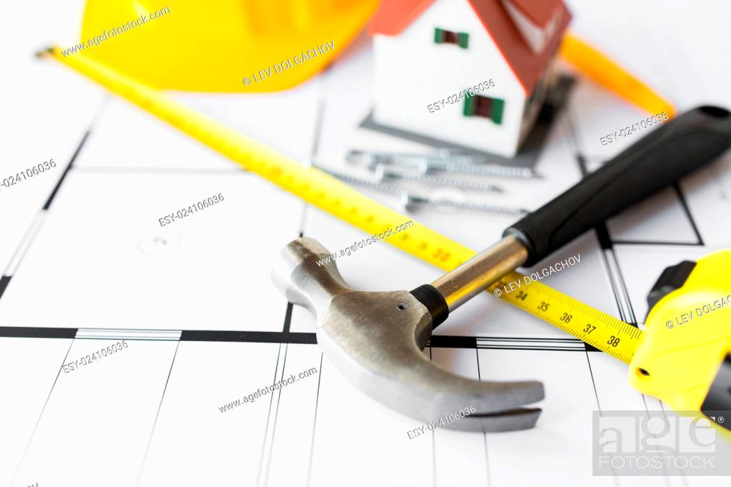 Stock Photo: architecture, building, construction, real estate and home concept - close up of living house model on blueprint with repair tools.