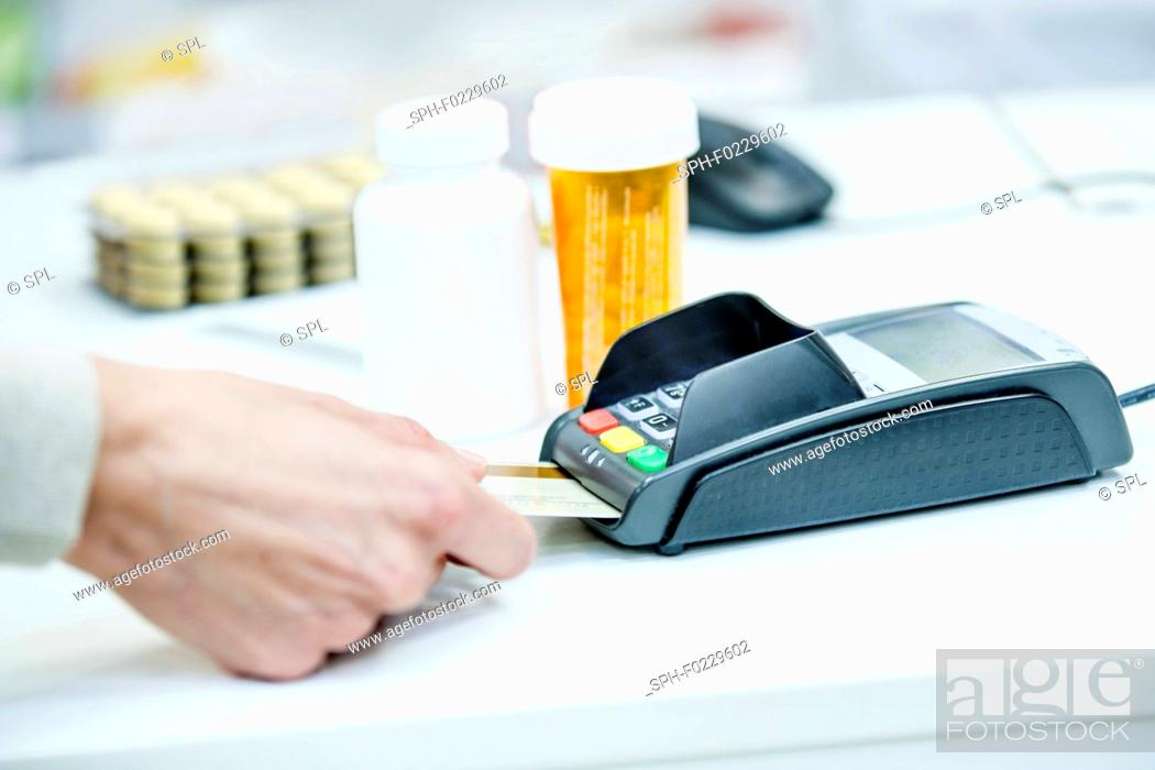 Stock Photo: Customer paying in pharmacy.