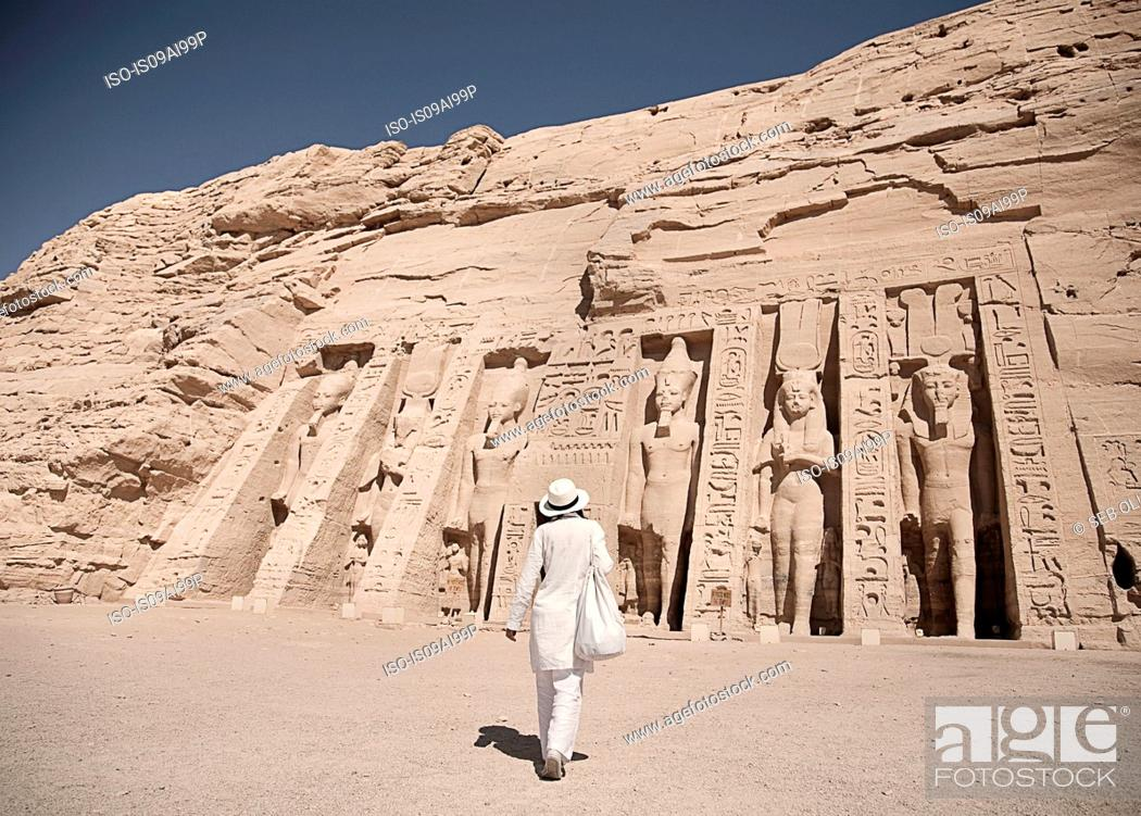 Stock Photo: Mature woman tourist at Abu Simbel, The Rock Temple in Nubia, Southern Egypt commemorating Pharaoh Ramesses II and his wife Queen Nefertari, Egypt.