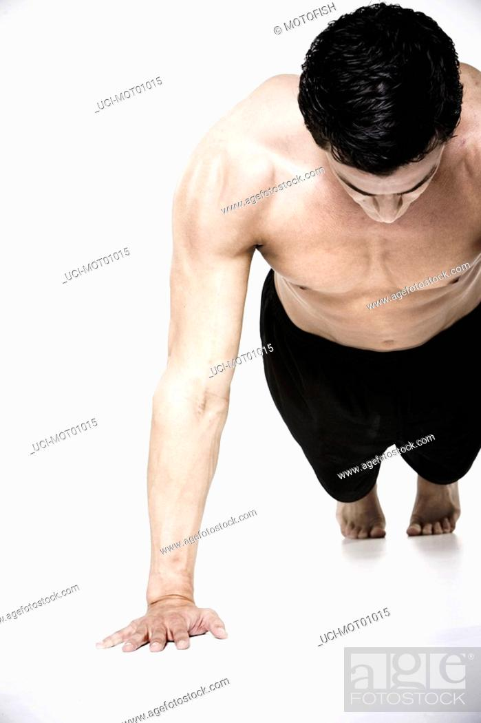 Stock Photo: Bare-chested man doing push-ups.