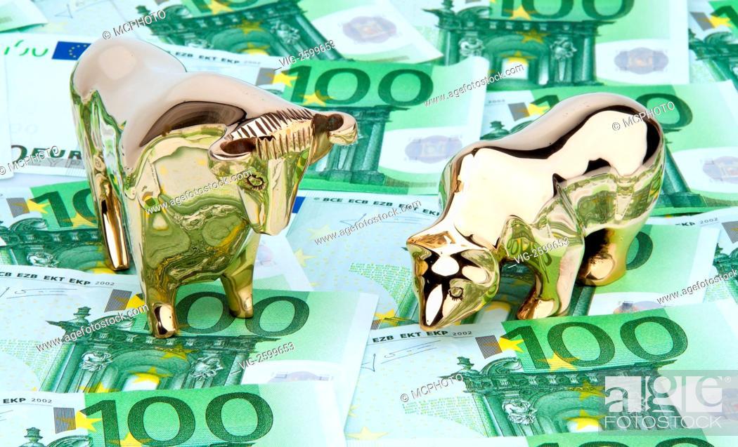 Stock Photo: Many euro banknotes. Bull and Bear - 01/01/2011.
