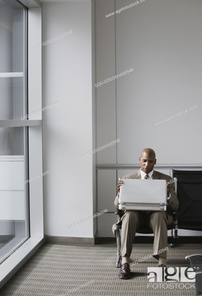 Stock Photo: African businessman in waiting area.