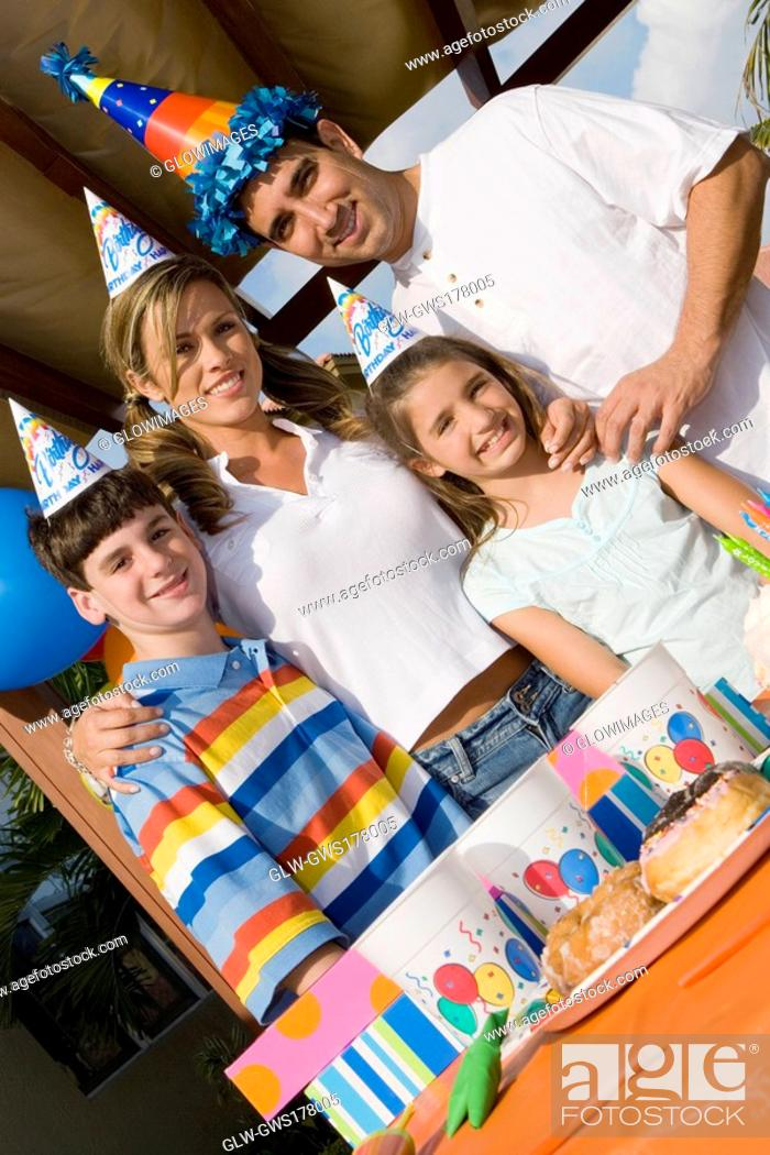 Stock Photo: Portrait of a family celebrating a birthday party.