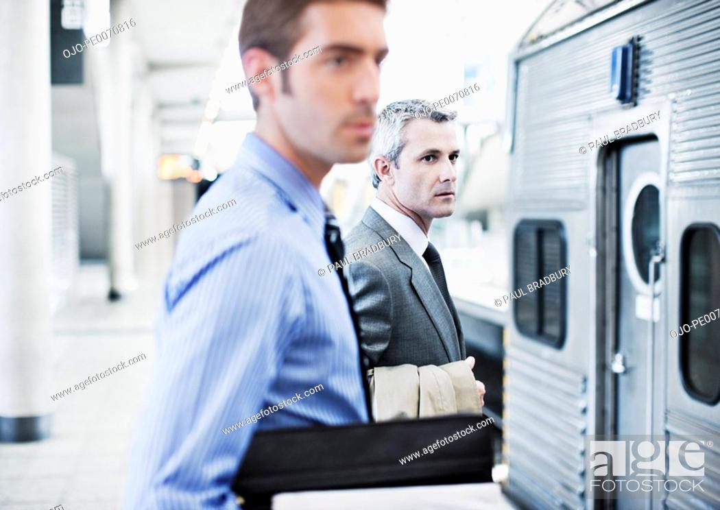 Stock Photo: Businessmen waiting for train in train station.