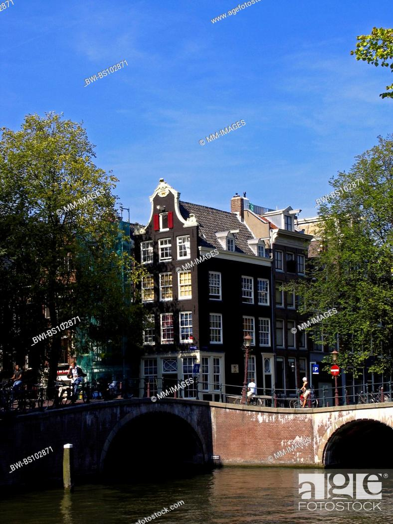 Stock Photo: view at canals, old bridges and a striking cornerhouse in Amsterdam, Netherlands.