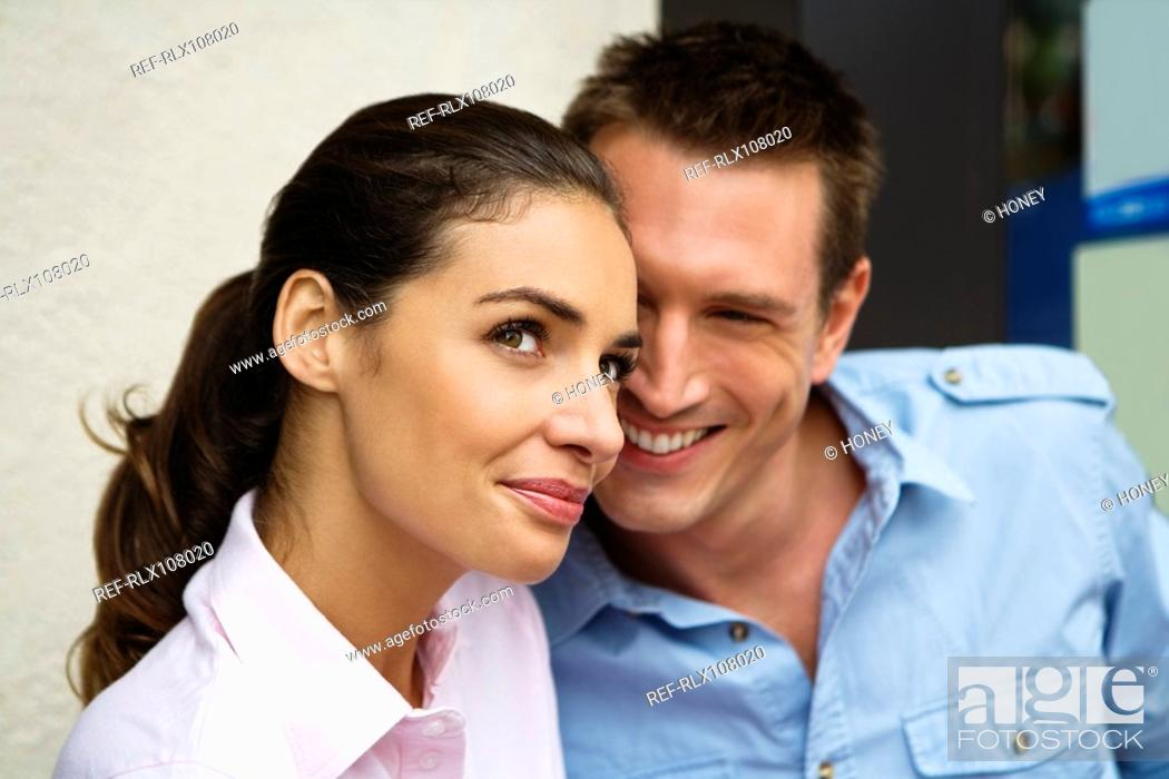 Stock Photo: Young couple outside street side cafe, Paris, France.