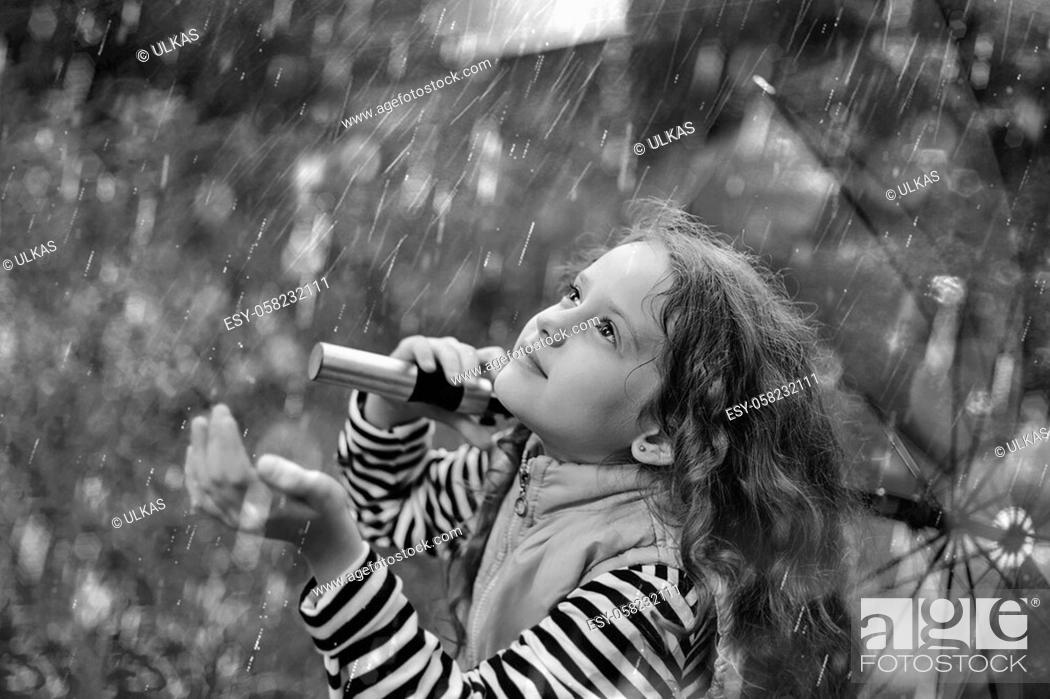 Stock Photo: Black and white portrait, little girl enjoy to spring rain.