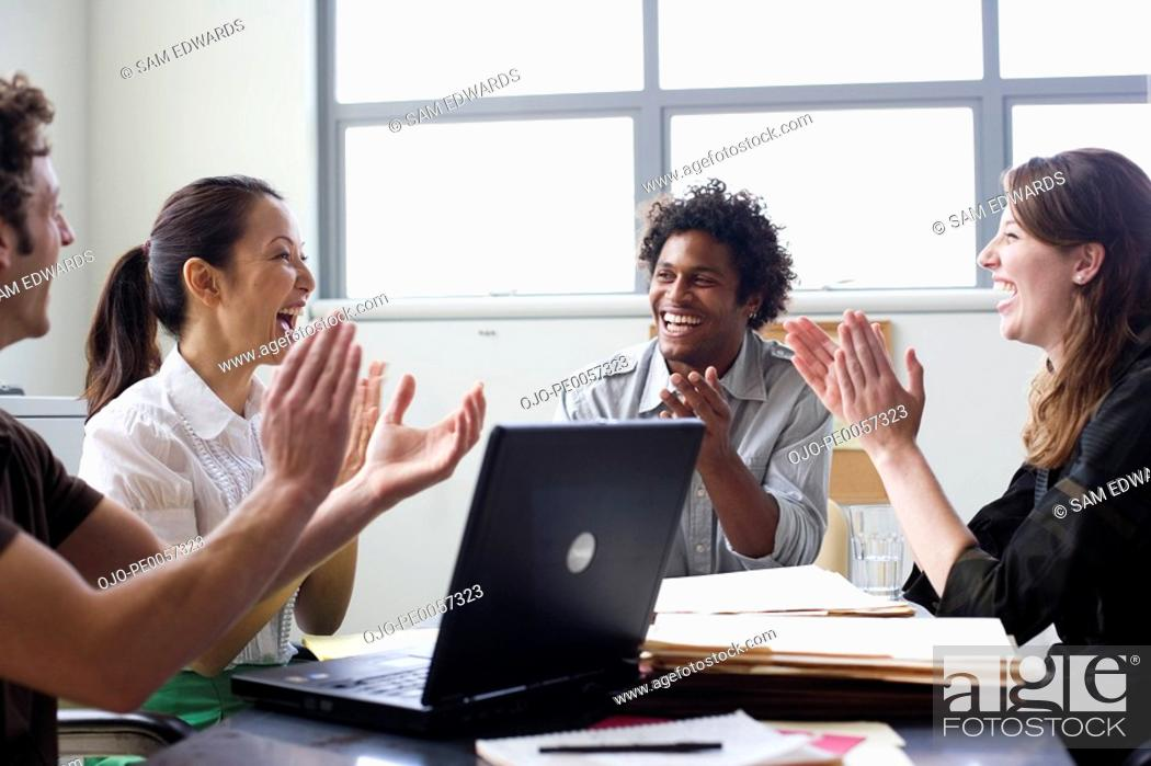 Stock Photo: Four businesspeople in office applauding.