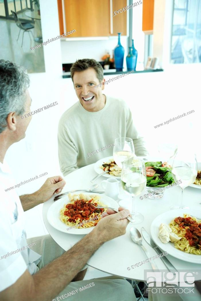 Stock Photo: Two mature men eating.