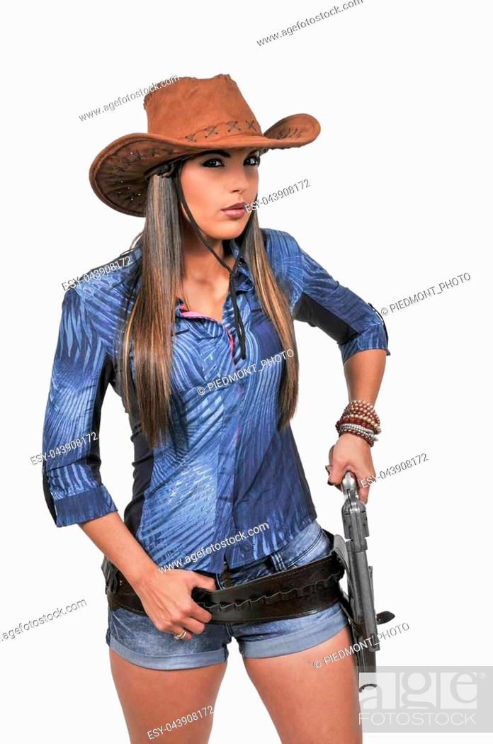 e5821336f2f Beautiful young country girl woman wearing a stylish cowboy hat and ...