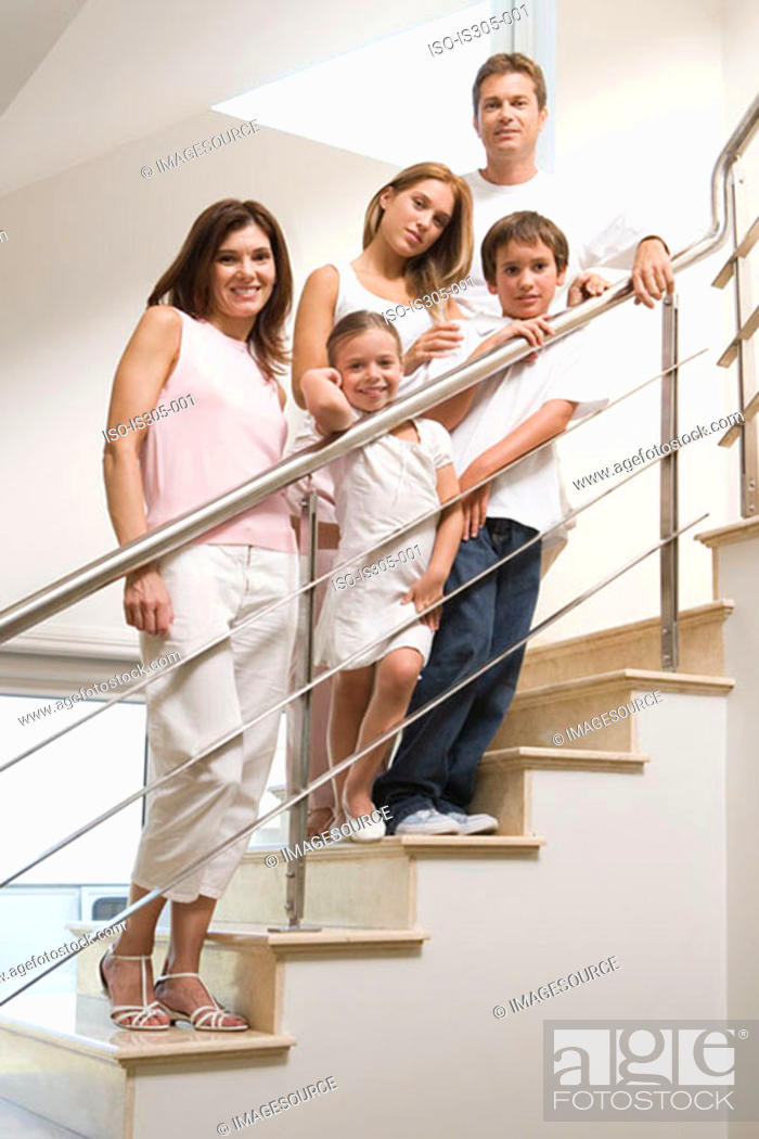 Stock Photo: Family standing on stairs.