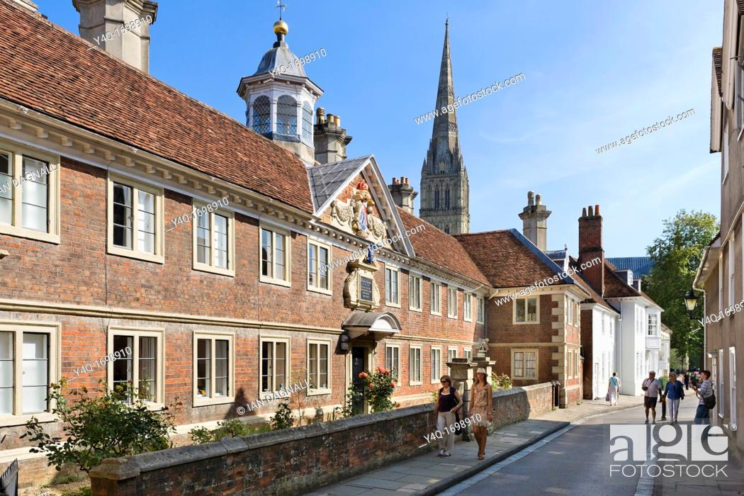 Stock Photo: Matron's College on The Close with the spire of Salisbury Cathedral behind, Salisbury, Wiltshire, England, UK.