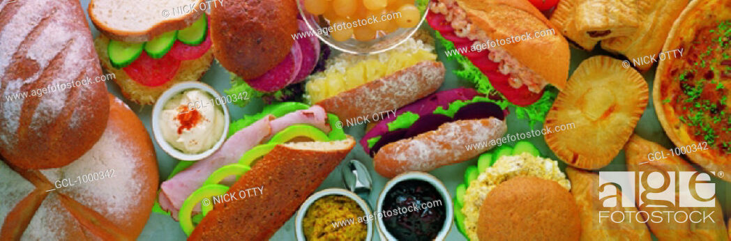 Stock Photo: Display of different sorts of sandwiches and pies.