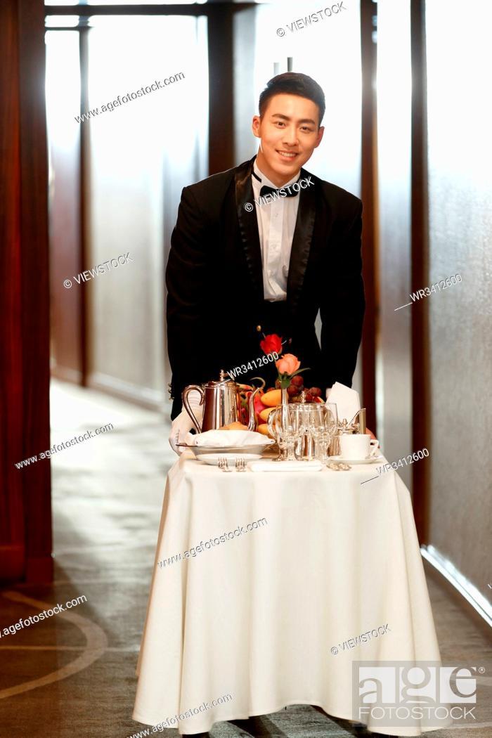 Stock Photo: The hotel waiter.
