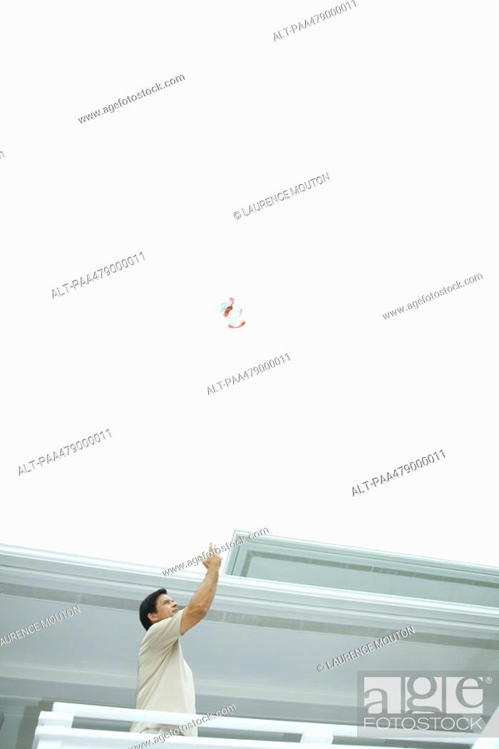 Stock Photo: Man throwing trash into the air.