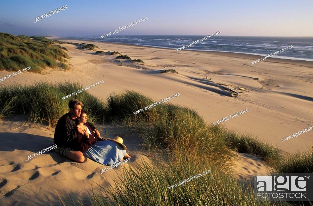 Stock Photo: USA, Oregon Dunes National Recreation Area - couple on sand.