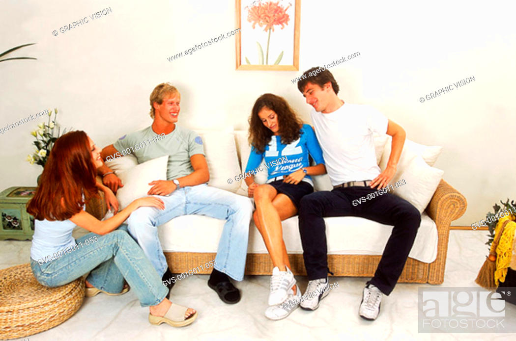 Stock Photo: Two young couples sitting and talking.