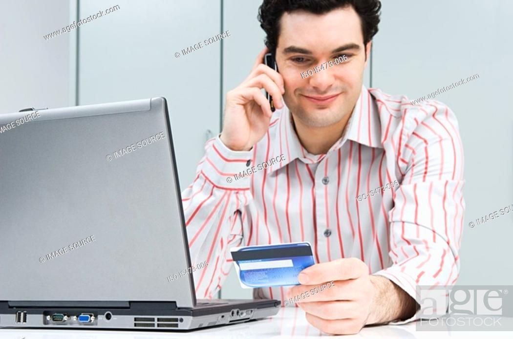 Stock Photo: Man telephone banking.