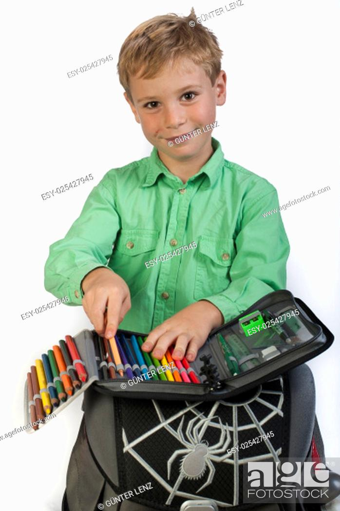 Stock Photo: 6-year-old boy with schoolbag and pencil case.