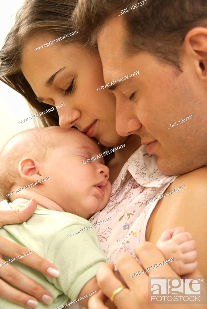 Stock Photo: Happy parents holding their baby son.
