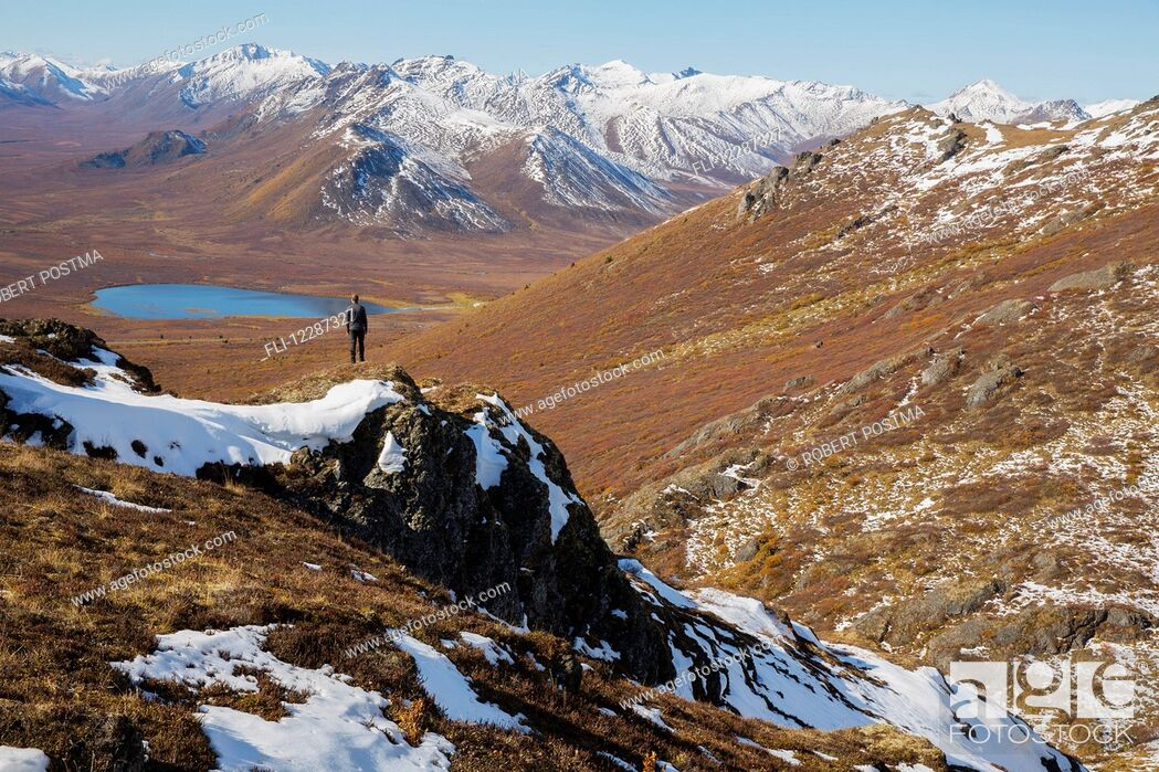 Stock Photo: Hiking on top of Angelcomb Peak along the Dempster Highway; Yukon, Canada.