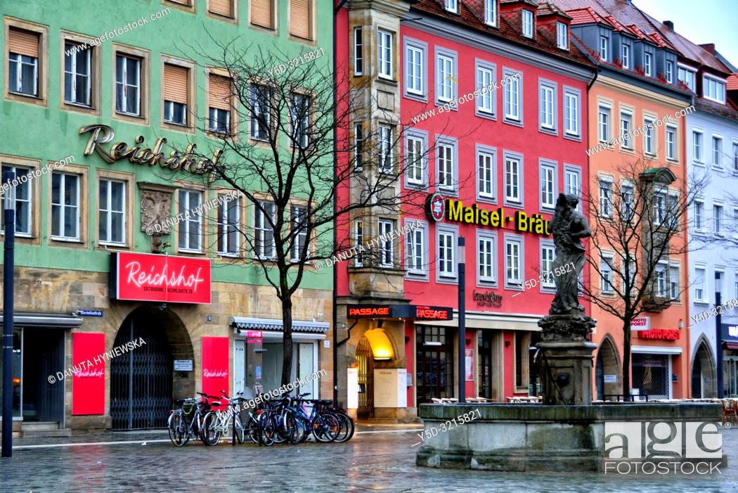 Stock Photo: Herkulesbrunnen, Hercules fountain, facades of historic townhouses in the evening, Maximilianstrasse - main touristic promenade in old town, Bayreuth.