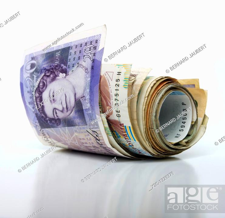 Stock Photo: Rolled bunch of banknotes, Pound sterling.