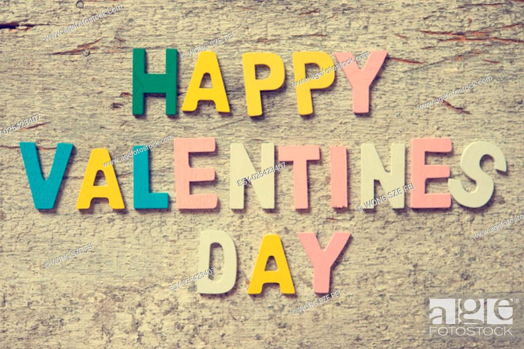 "Stock Photo: The colorful words """"HAPPY VALENTINES DAY"""" made with wooden letters on old wooden board."