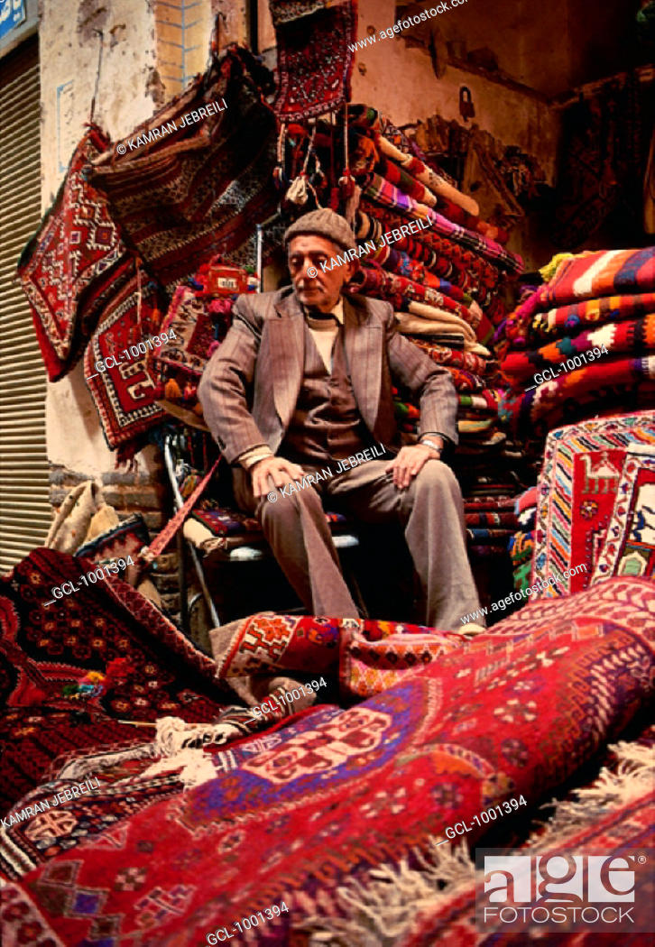 Stock Photo: Owner of a carpet shop in Iran.