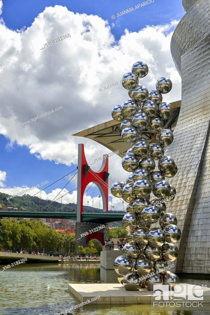 Stock Photo: Tall Tree and the eye by Anish Kapoor, Bilbao, Biscay, Basque Country, Euskadi, Euskal Herria, Spain, Europe.