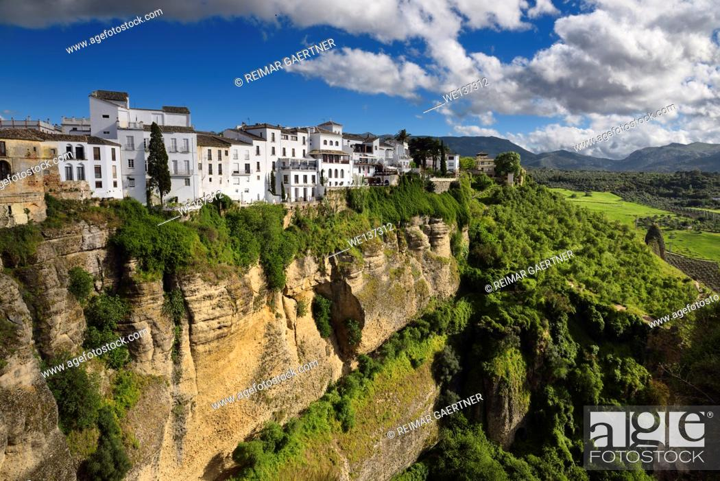 Stock Photo: El Tajo Canyon on the Guadalevin river with white Ronda buildings Andalusia Spain.