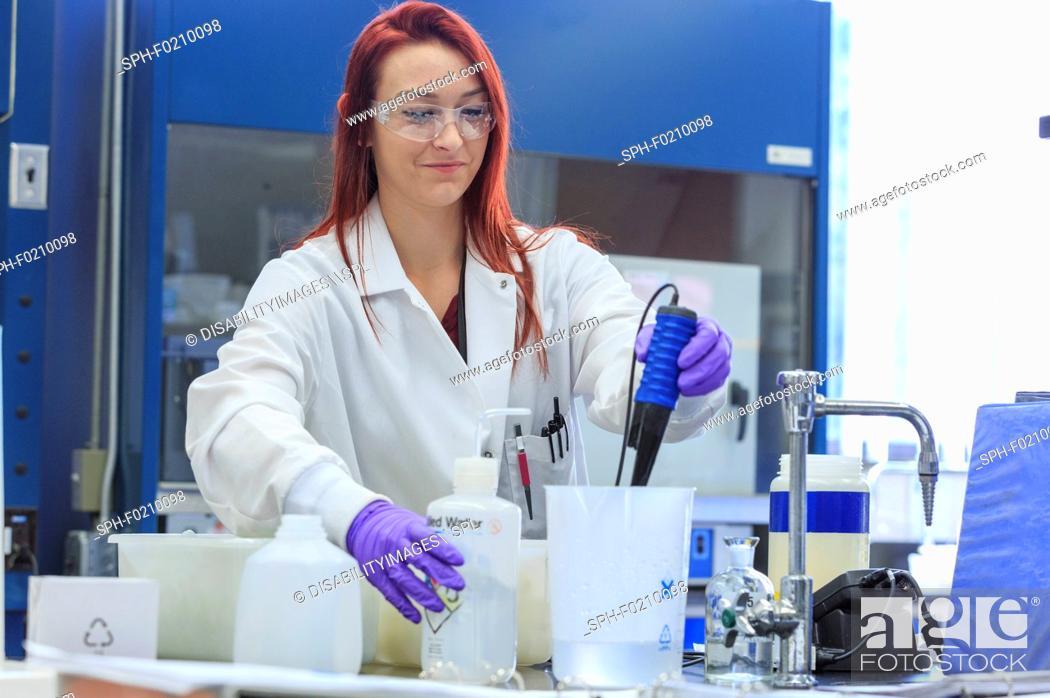 Stock Photo: Chemist measuring pH.