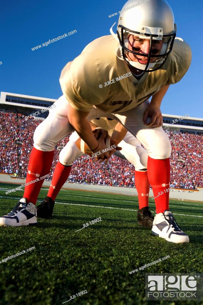 Stock Photo: Center snapping football to quarterback.