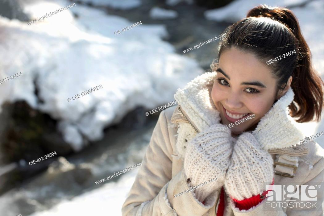 Photo de stock: Portrait of smiling woman in snow.