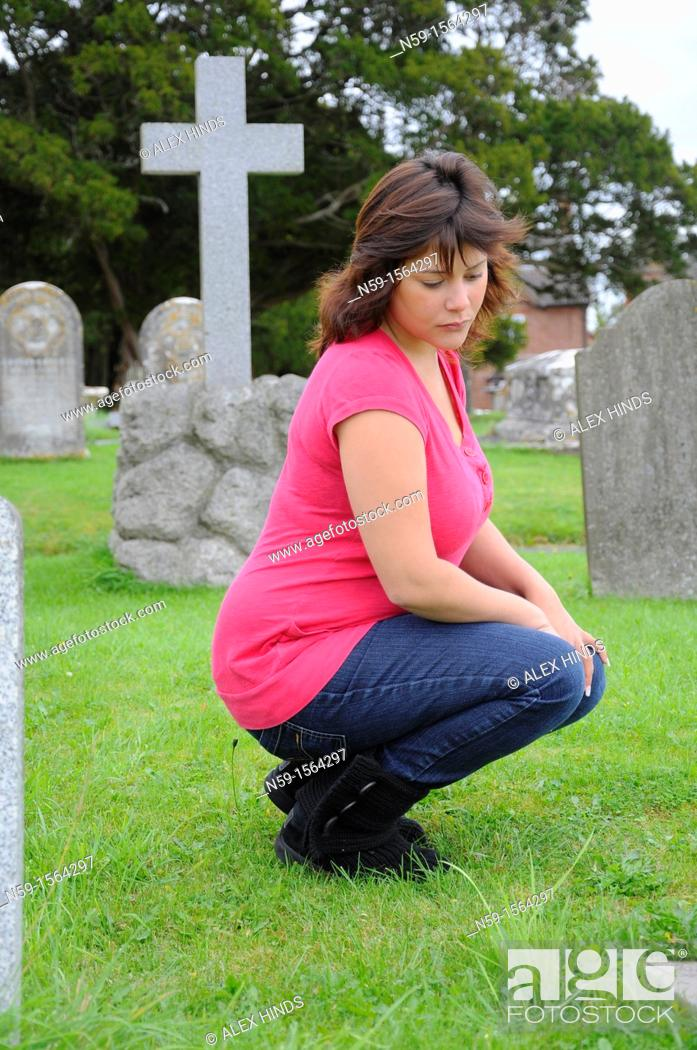 Stock Photo: Woman in cemetery.