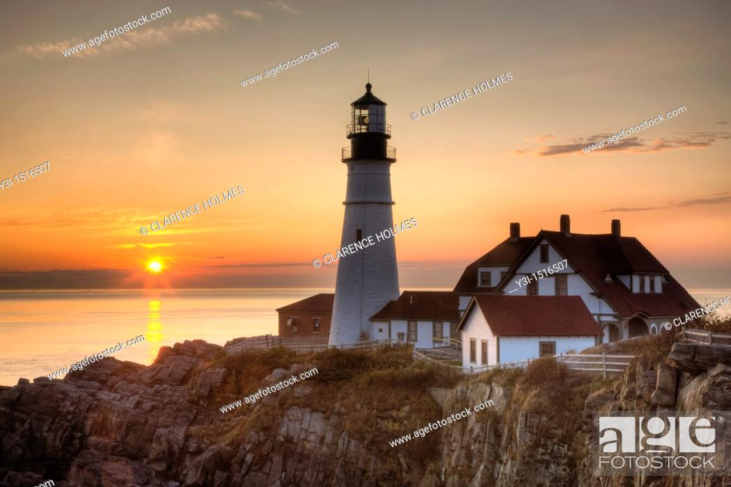 Stock Photo: The first rays of sun after sunrise reach the Portland Head Light, built in 1791, which protects mariners entering Casco Bay.
